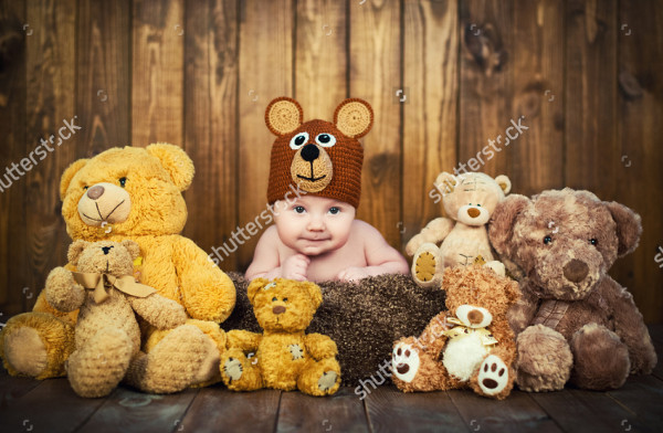 Newborn Baby in a Knitted Cap Bears